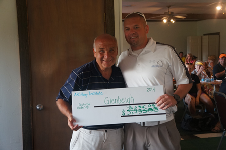 John Stuckey (Executive Director of ARCHway Institute) handing Gary  Seech (Director at Glenbeigh) a Check from the 2014 Ohio Golf Outing